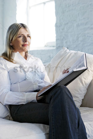 Tidy : A confident looking business lady sitting on a couch