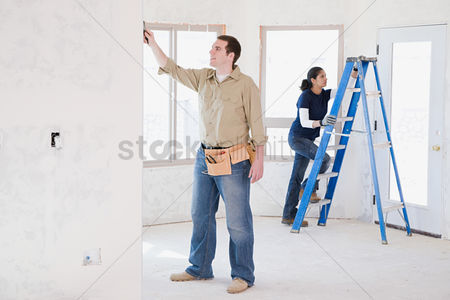 Interior : A couple doing building work