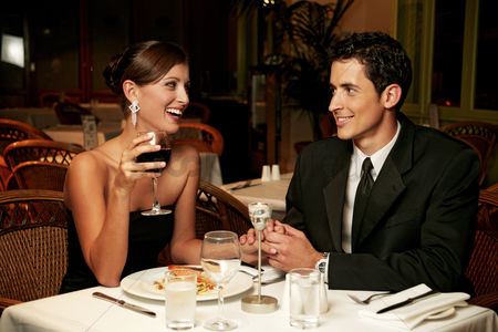 Lover : A couple in dinners wear celebrating their anniversary in the restaurant