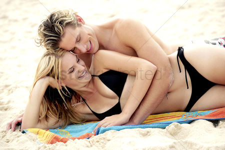 Girlfriend : A couple lying together on the beach