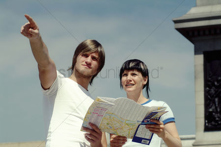 Girlfriend : A couple referring to a map for directions