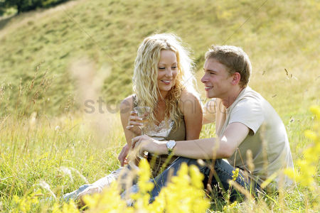 Affectionate : A couple sitting on the prairie chatting