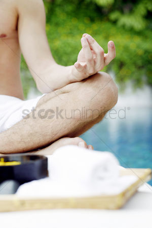 Contemplation : A guy doing meditation at the poolside
