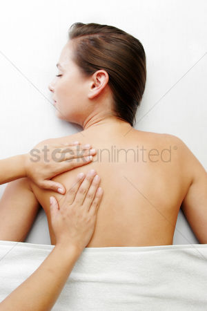 Satisfying : A hand massaging a lady s back
