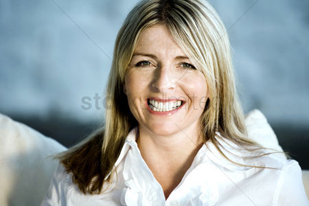 Tidy : A happy business lady looking at the camera