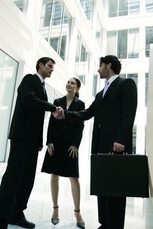 Client : A lady watching as two guys shaking their hands