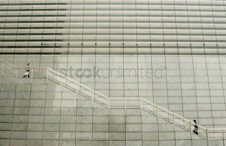 Stairs : A man going up while another going down the stairs