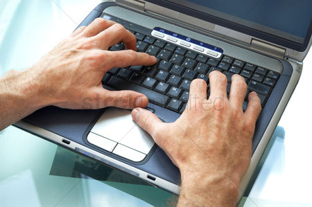 Hobby : A pair of hands typing the laptop