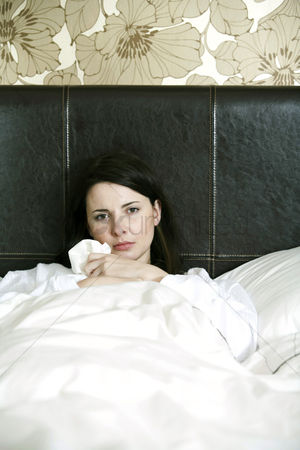 Moody : A sick woman in bed