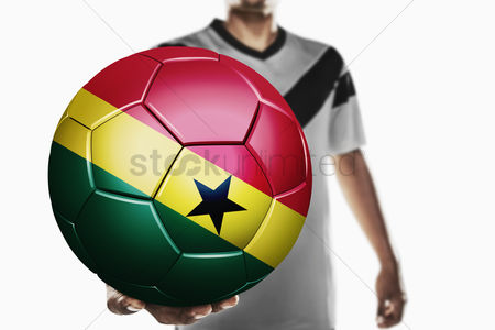 Nationality : A soccer player holding ghana soccer ball