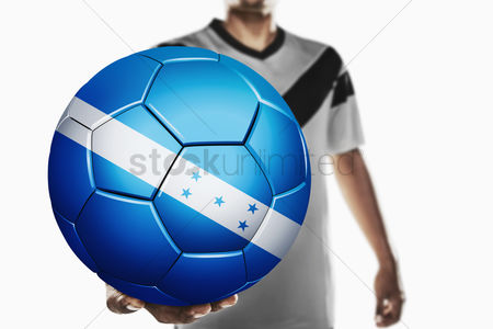 Nationality : A soccer player holding honduras soccer ball