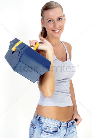 Excited : A woman carrying a tool box