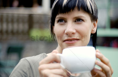 Rest : A woman drinking a cup of coffee