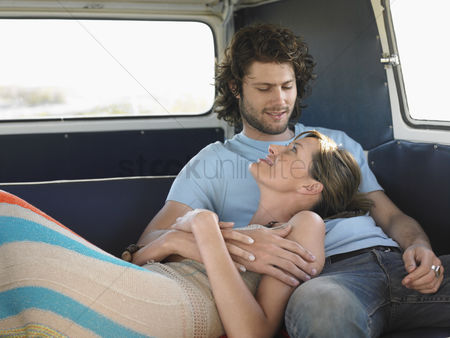 Closeness : Affectionate young couple relaxing in camper van