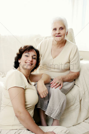 White hair : An old lady and her daughter flashing a smile at the camera