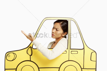 Bidayuh ethnicity : Annoyed woman looking out of a cardboard car window