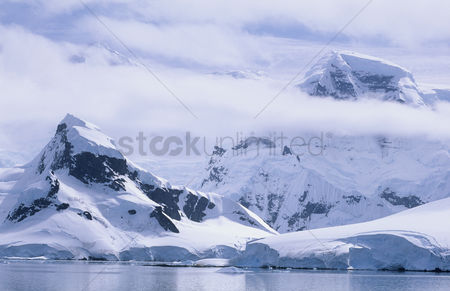 Land : Antarctica snow covered mountains and icebergs