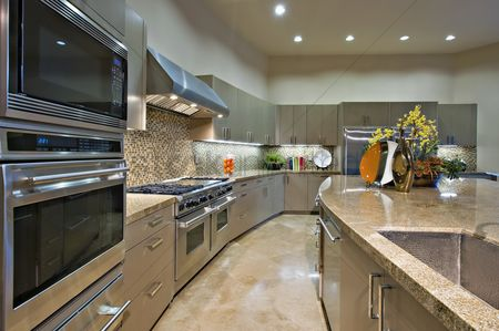 Interior : Architecturally designed kitchen with stainless steel fitted units