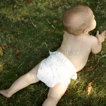 Lying forward : Baby boy lying forward in the park