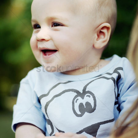 Adorable : Baby boy smiling while looking to the side