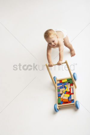 Steps : Baby pushing cart of blocks