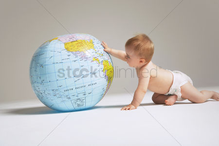 Children : Baby touching inflatable globe