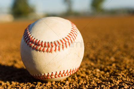 Sports : Baseball on ground  close-up