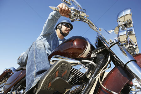 Transportation : Biker riding motorcycle low angle view