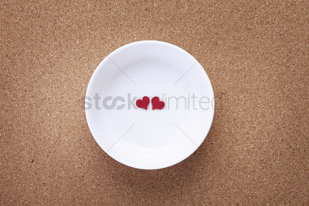 Heart shapes : Bowl with two red heart shapes