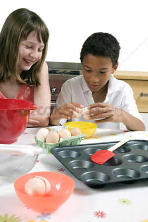 Egg tray : Boy and girl learning baking