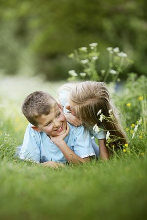 Lying forward : Boy and girl looking at each other