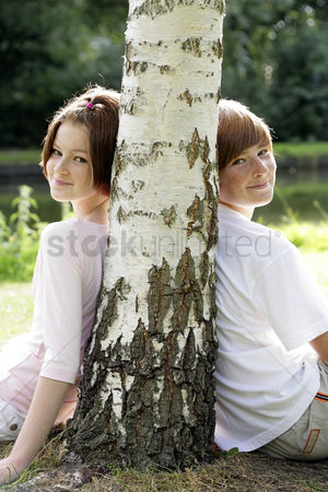 First : Boy and girl sitting under a tree
