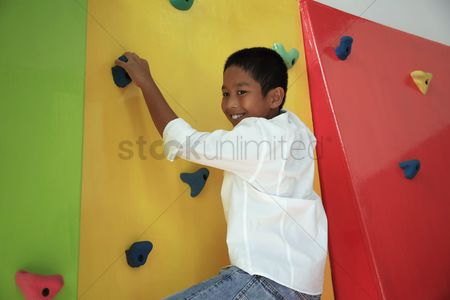 Rock wall : Boy climbing rock wall