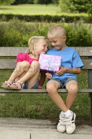 Birthday present : Boy giving a present to girl