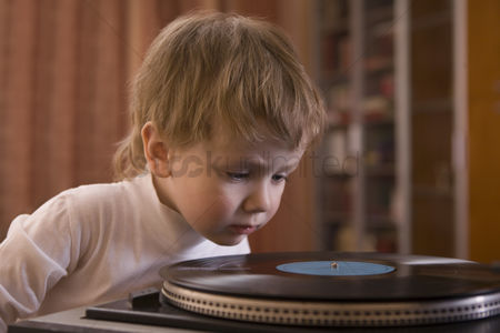 Traditional clothing : Boy listening to record player