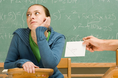 Ignorance : Boy passing girl a letter in class