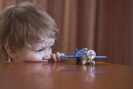 Pre teen : Boy playing with toy airplane