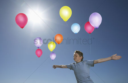 Spirit : Boy releasing balloons