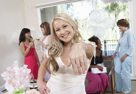 Celebrating : Bride showing off ring at bridal shower