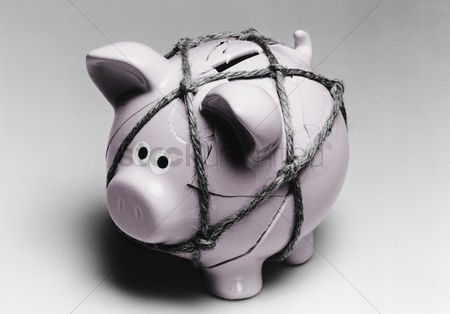 Loss : Broken piggy bank reassembled with twine