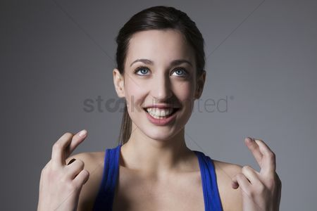 Blue background : Brunette with finges crossed
