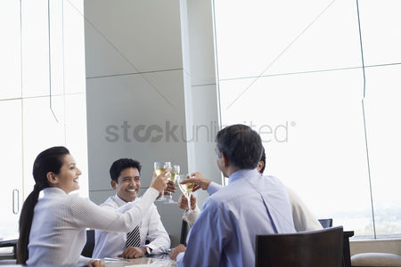 Toasting : Business associates toasting with wine glasses