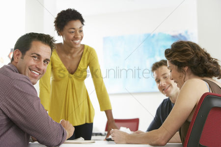 Smiling : Business colleagues in office meeting