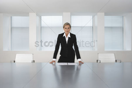 Leadership : Business executive standing in conference room