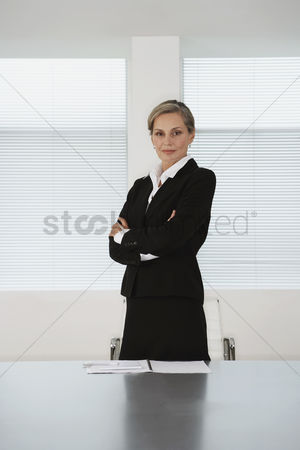 Determined : Business executive standing in conference room