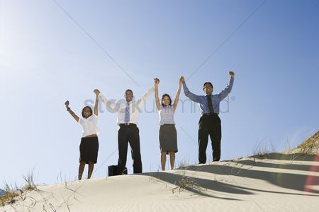 Asian : Business people cheering in the desert