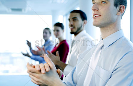 Lady : Business people clapping hands after watching a great presentation