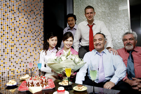 Celebrating : Business people posing at a birthday party