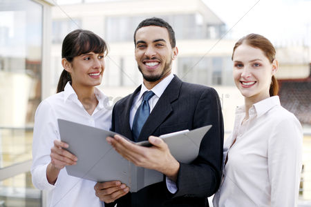Smiling : Business people posing in a group