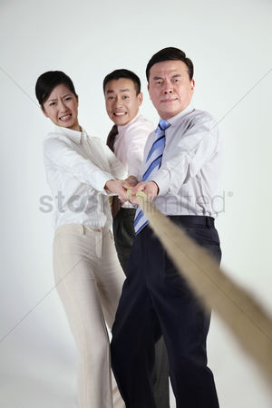Frowning : Business people tugging rope